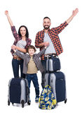 Travel. Happy family with luggage are ready to travel. Isolated on white background Stock Photos