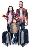 Travel. Happy family with luggage are ready to travel. Isolated on white background Royalty Free Stock Photography