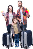 Travel. Happy family with luggage are ready to travel. Isolated on white background Stock Photo