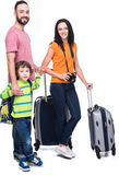 Travel. Happy family with luggage are ready to travel. Isolated on white background Stock Images