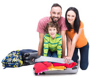 Travel. Happy family with luggage are ready to travel. Isolated on white background Royalty Free Stock Image