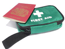 Travel health. A british passport with first aid kit Stock Photos