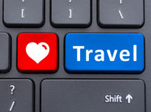 Travel and heart symbol text buttons on keyboard Stock Images