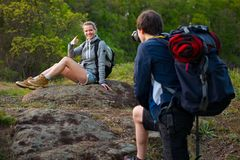 Travel, hiking, backpacking, tourism and people concept. Smiling. Couple with backpacks taking picture by camera in nature Stock Photos