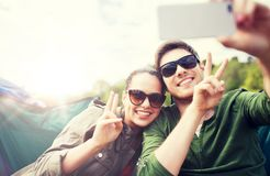 Couple of travelers taking selfie by smartphone royalty free stock photography