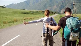 Travel hitchhiker couple on a road stock footage