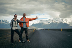 Travel hitchhiker couple on a road Stock Image