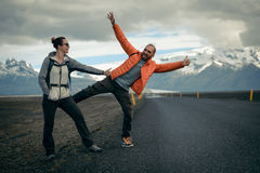 Travel hitchhiker couple on a road Stock Photo