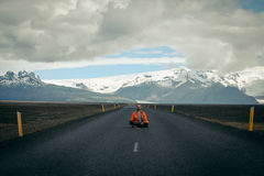 Travel hitchhiker man meditating on a road Royalty Free Stock Photos