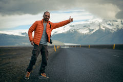 Travel hitchhiker man on a road Royalty Free Stock Image