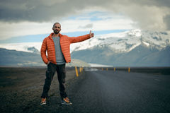 Travel hitchhiker man on a road Royalty Free Stock Images