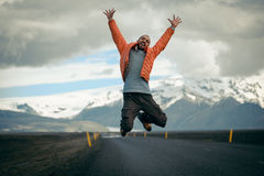 Travel hitchhiker man on a road Royalty Free Stock Photography