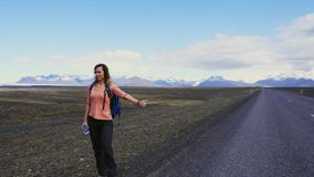 Travel hitchhiker woman walking on a road stock video