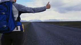 Travel hitchhiker woman walking on a road stock video footage