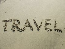 Travel - holiday concept. Useful for travel agencies or travel industry. Words in sand written by hand: travel stock images