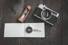 TRAVEL INSURANCE, vintage camera and compass on wooden background. Travel and holiday concept,word block TRAVEL INSURANCE, vintage camera and compass on wooden Royalty Free Stock Photo
