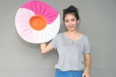 Travel holiday concept. Young Asian woman holding big colorful s stock images
