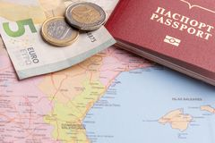 Travel and Holiday Packages - Russian international passport, euro, maps. Travel and tourist packages - Russian passport, euro, vacation planning cards royalty free stock photos