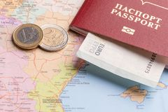 Travel and Holiday Packages - Russian international passport, euro, maps. Travel and tourist packages - Russian passport, euro, vacation planning cards stock images