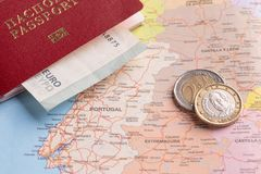 Travel and Holiday Packages - Russian international passport, euro, maps. Travel and tourist packages - Russian passport, euro, vacation planning cards stock photo