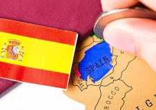 Travel holiday to Spain concept with passport. And flag with female hand choosing Spain on the map Stock Images