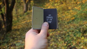 Travel holiday tourism vacation idea. Hand holding a book with the inscription. Travel idea stock footage