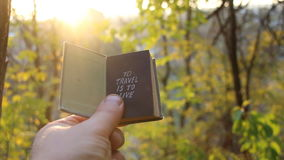 Travel Holiday Tourism Vacation idea. Hand holding a book with the inscription. Travel idea stock video footage
