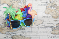 Travel holiday vacation. Travel vacation holiday concept with sunglasses on world map Royalty Free Stock Photo