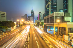 Travel. Hongkong trafic trails clicked at slow shutter speed Royalty Free Stock Images