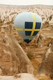 Travel. Hot Air Balloon Flying Above Rock Valley, Ballooning. In Cappadocia Turkey. High Resolution stock photos