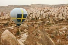 Travel. Hot Air Balloon Flying Above Rock Valley, Ballooning. In Cappadocia Turkey. High Resolution stock photography
