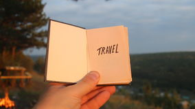 Travel idea. Book with the inscription. Book with the inscription Travel. Forest on background stock video