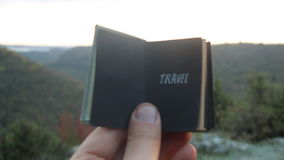 Travel idea. Book with the inscription. Book with the inscription Travel. Forest on background stock footage