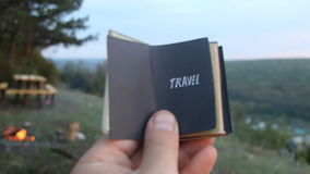 Travel idea. Retro book with the inscription. Book with the inscription Travel. Forest on background stock footage