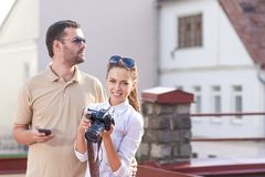 Young Caucasian Couple Traveling Through the City and Taking PIctures. Stock Photography