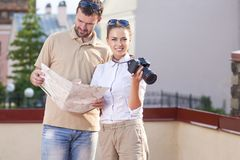Young Caucasian Couple Traveling Through the City and Taking Pictures. Royalty Free Stock Photo
