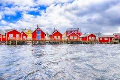Travel Ideas. Red Fisherman Houses on Lofoten islands stock photography