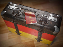 Travel or immigration concept. Passport of Germany and suitcase Stock Photography