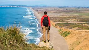 Free Travel In Point Reyes National Seashore, Man Hiker With Backpack Enjoying View, California, USA Royalty Free Stock Images - 168454079