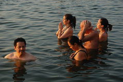 Travel India. At early morning foreigners praying in the Ganges river at Varanasi-India Stock Photography