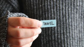Travel - inscription on the tag. The guy holds a tag with the text in his hand stock video footage