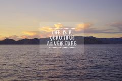Travel inspirational quotes - Life is a beautiful adventure. Blu. Rry retro styled background royalty free stock photo