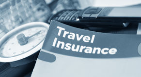 Travel insurance. Concept with luggage scape, passport and information leaflet Royalty Free Stock Photo