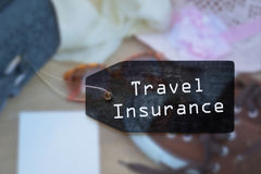 Travel Insurance. Black label tied to a suitcase Royalty Free Stock Image