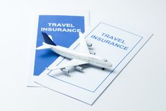 Travel insurance brochures. Two travel insurance brochures with an airplane model on top Royalty Free Stock Photo