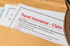 Travel Insurance Claim application form and hat with eyeglass on Royalty Free Stock Images