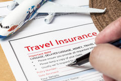 Travel Insurance Claim application form and hat with eyeglass an Royalty Free Stock Images