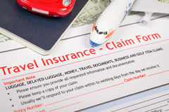 Travel Insurance Claim application form on table, business and r Stock Photos