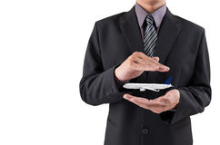 Travel insurance concept. Insurance agent with protective gesture and plane.  royalty free stock image