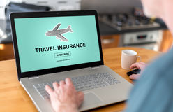 Travel insurance concept on a laptop Stock Photos